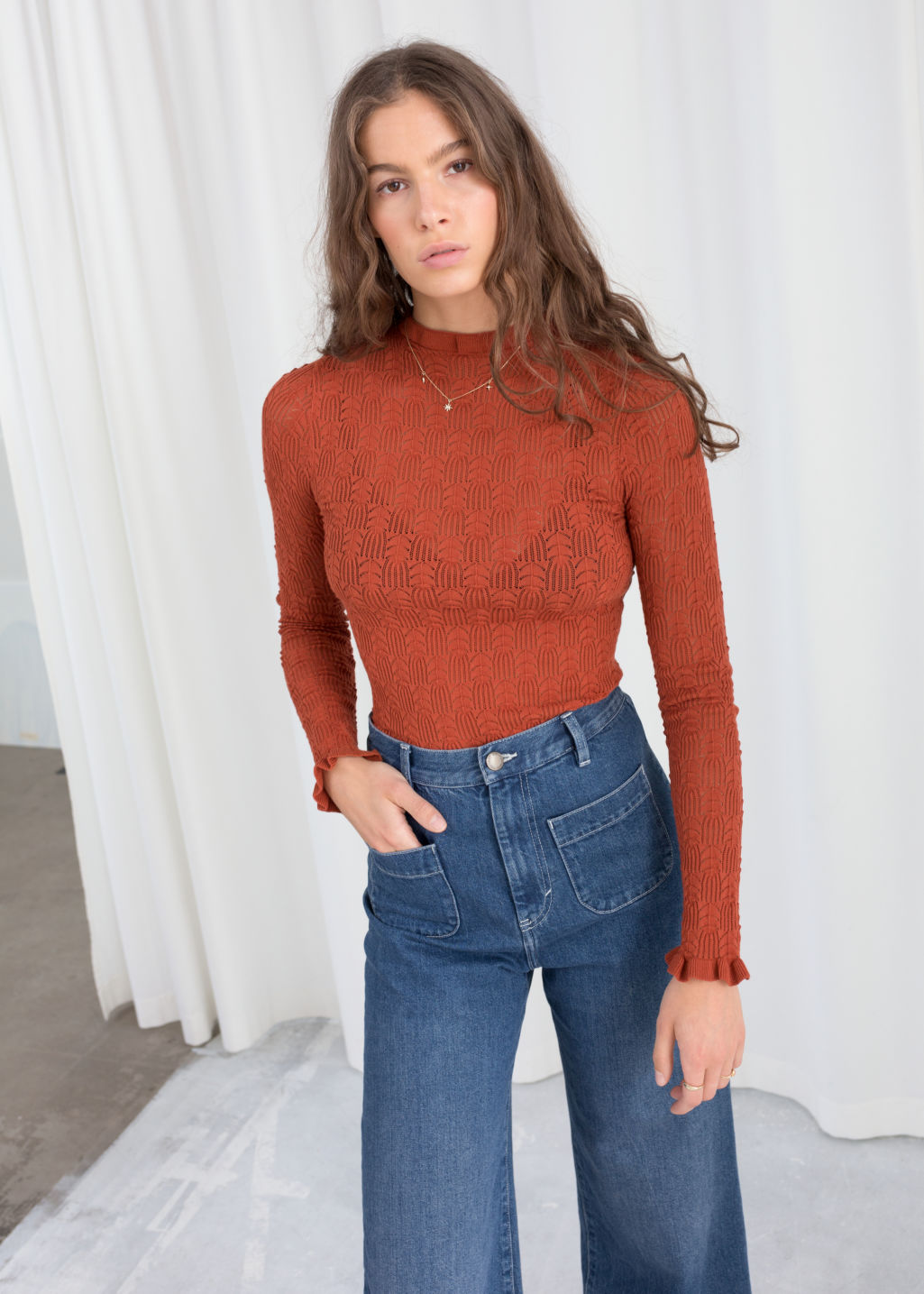 Model front image of Stories eyelet knit top in red