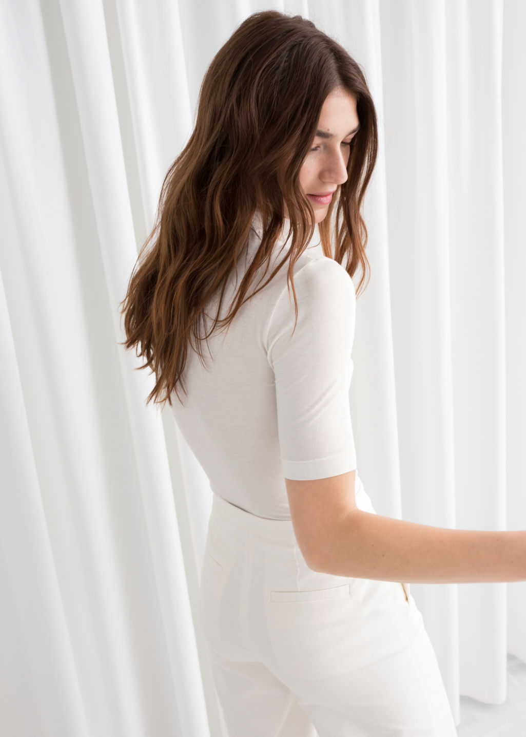 Model back image of Stories short sleeve turtleneck in white