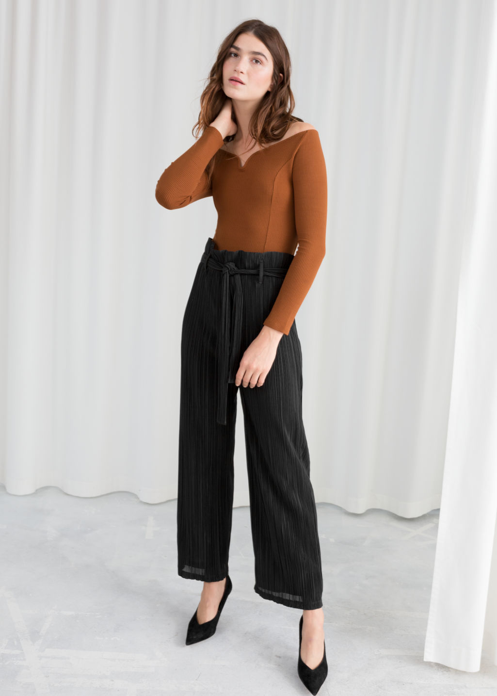 Model front image of Stories belted paperbag waist trousers in black