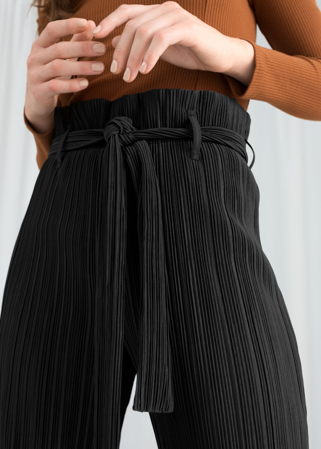 Model back image of Stories belted paperbag waist trousers in black