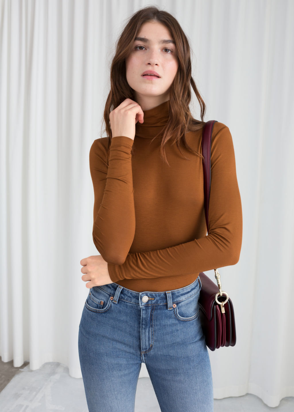 Model front image of Stories fitted stretch turtleneck in beige