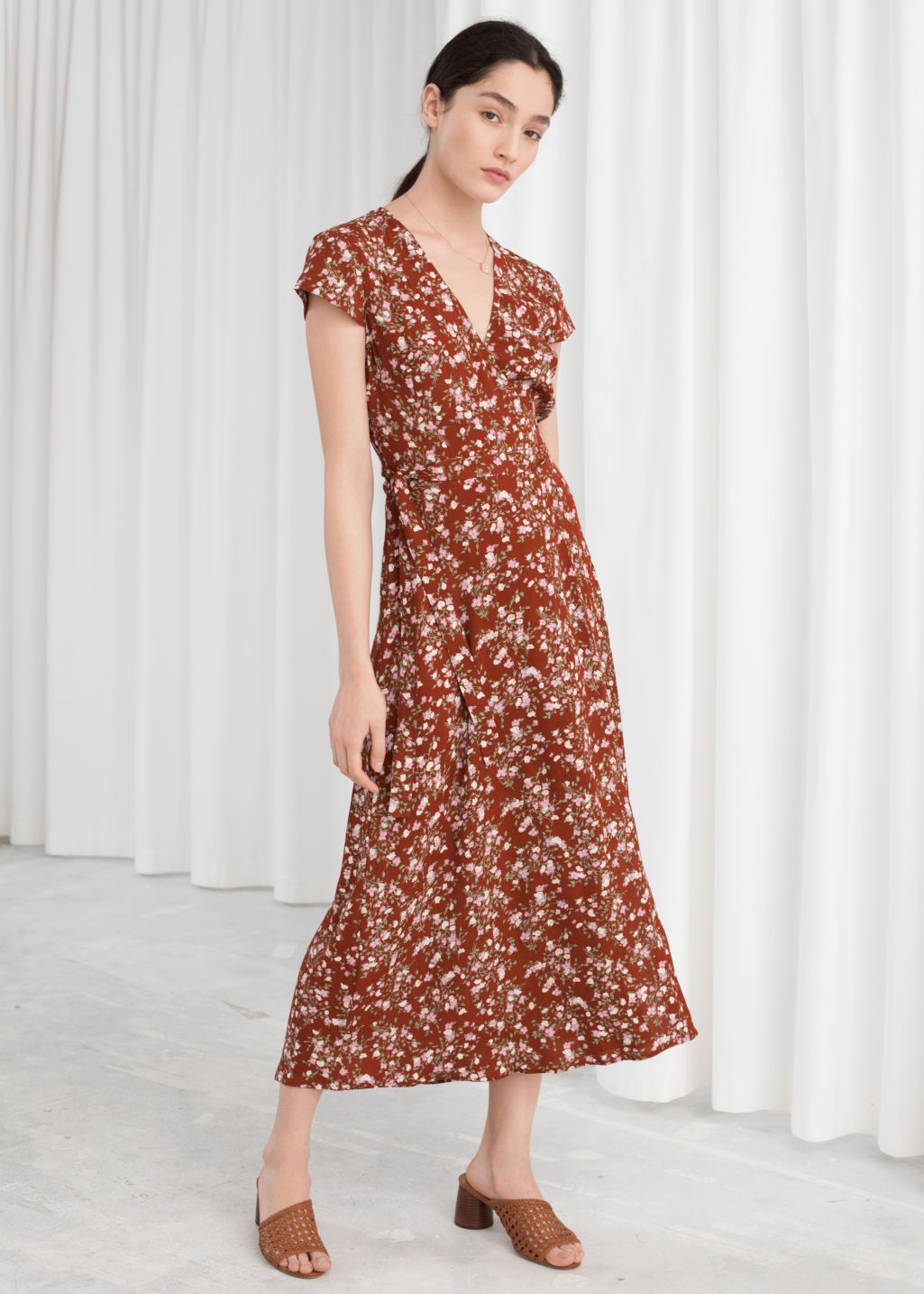 Model front image of Stories floral midi wrap dress in orange