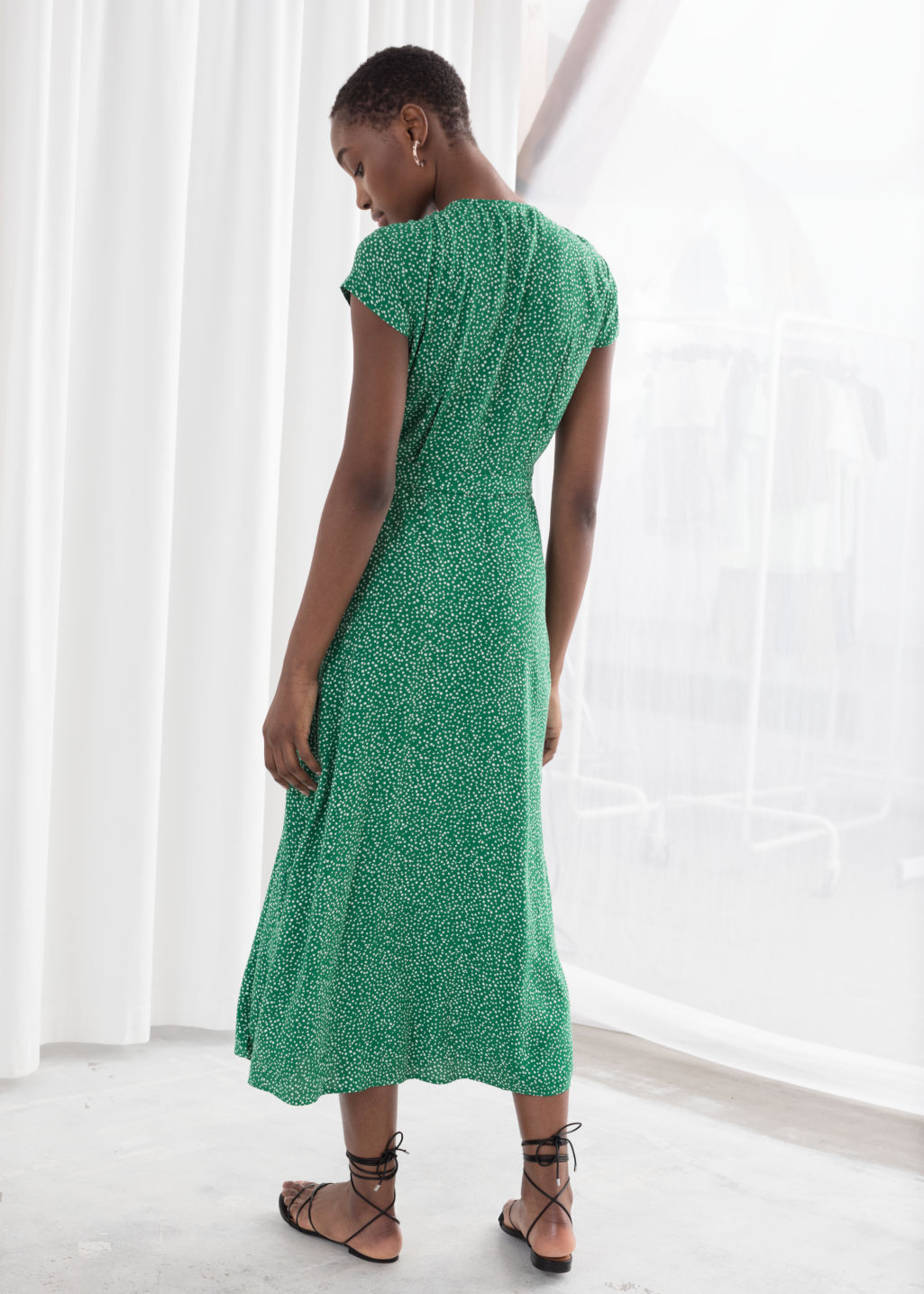 Model back image of Stories floral midi wrap dress in green