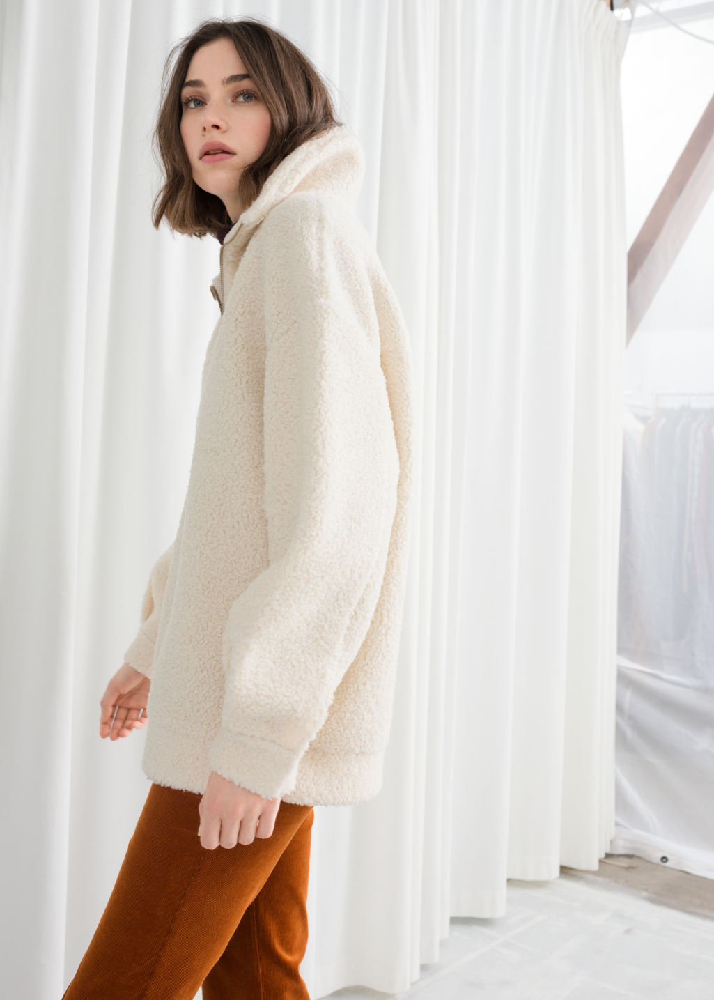 Model back image of Stories faux shearling zip pullover in white