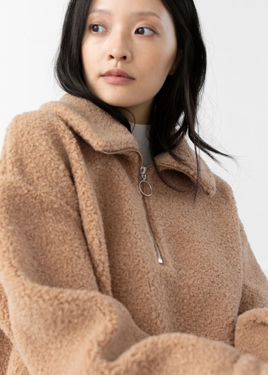 Model front image of Stories faux shearling zip pullover in beige