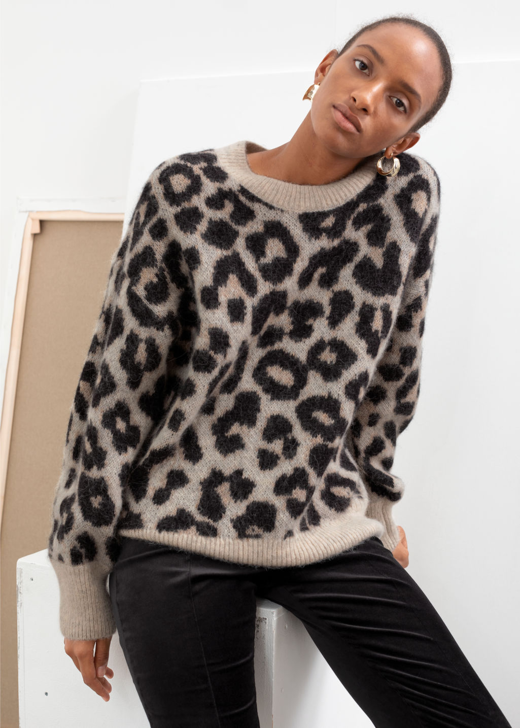 Model front image of Stories oversized leopard sweater in black