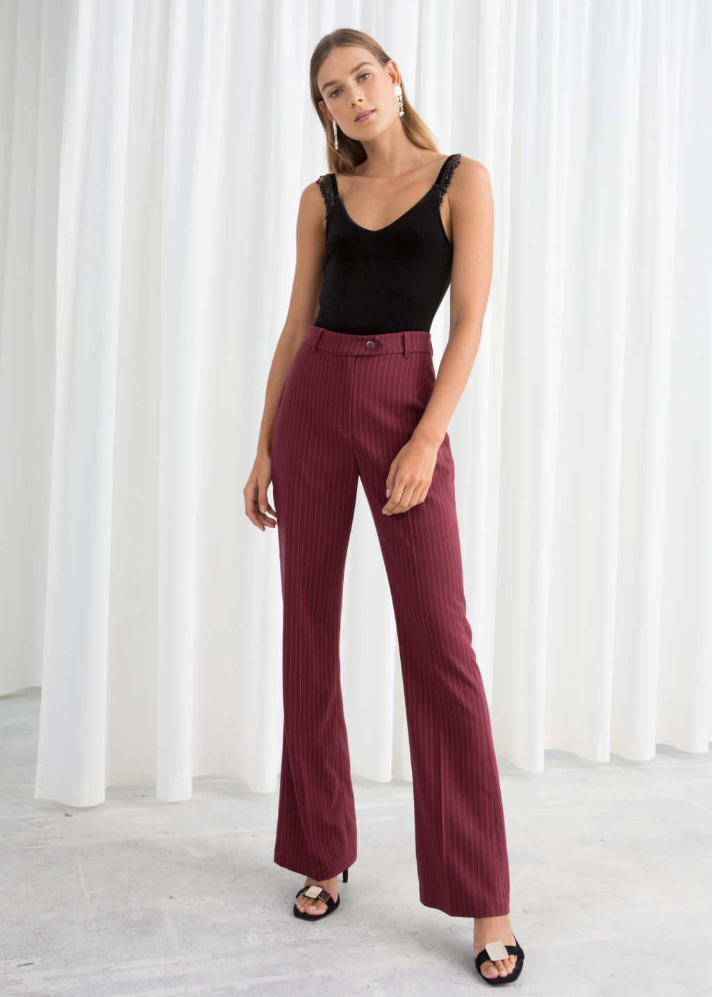 Model front image of Stories kick flare pinstripe trousers in red