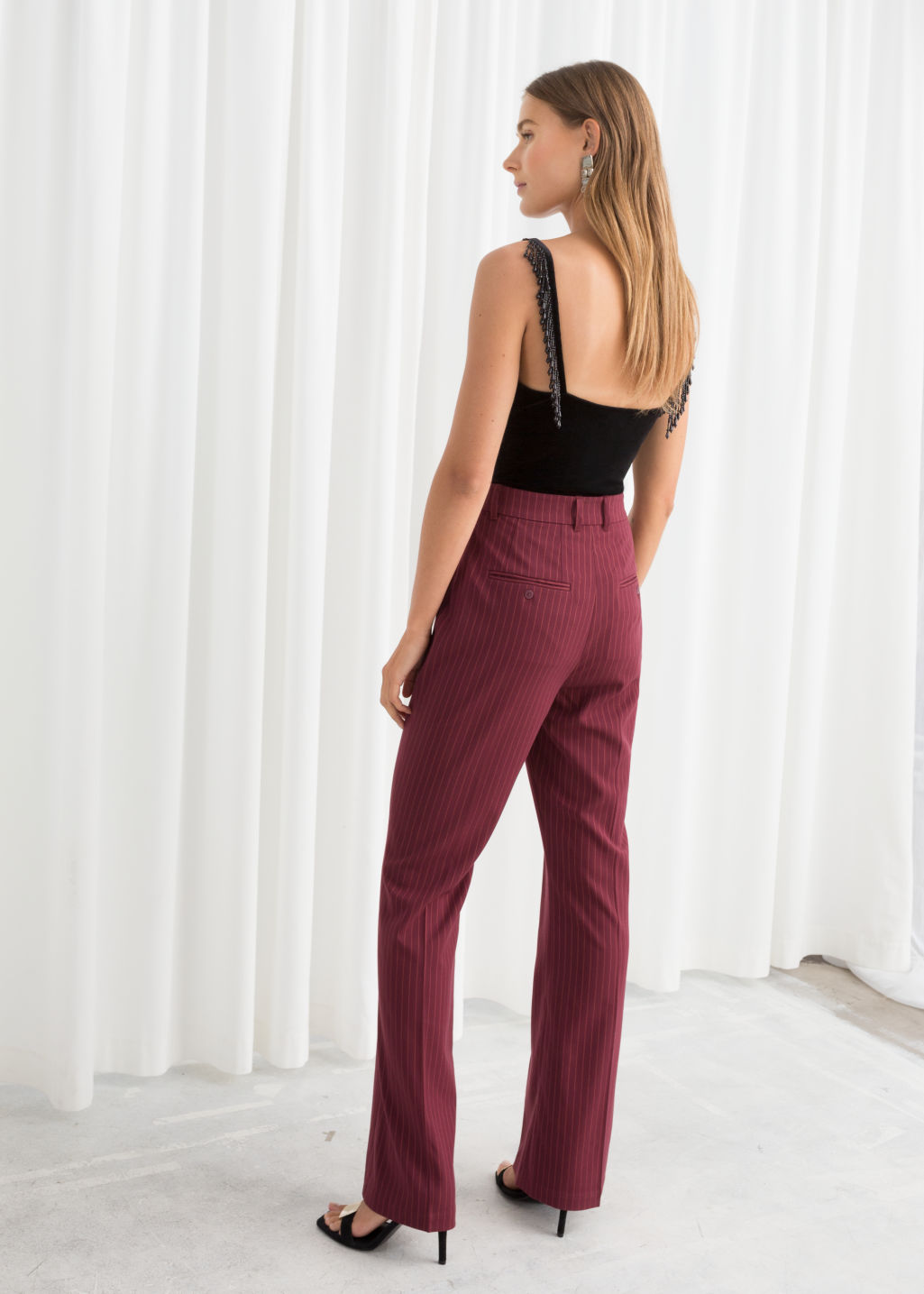 Model back image of Stories kick flare pinstripe trousers in red