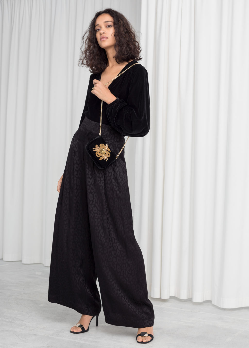 Model front image of Stories leopard satin jacquard trousers in black