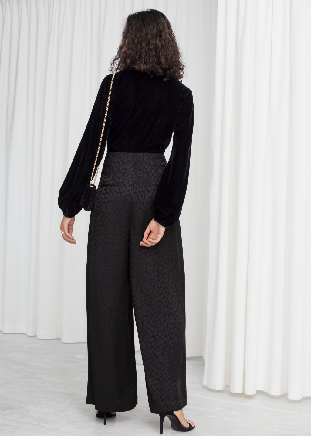 Model back image of Stories leopard satin jacquard trousers in black