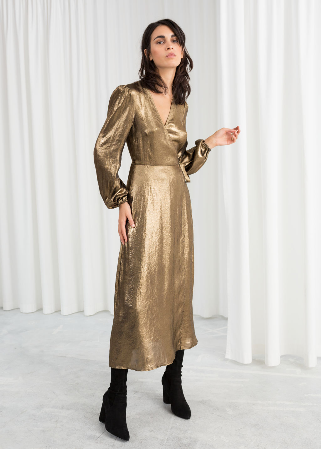 Model front image of Stories metallic satin midi dress in gold