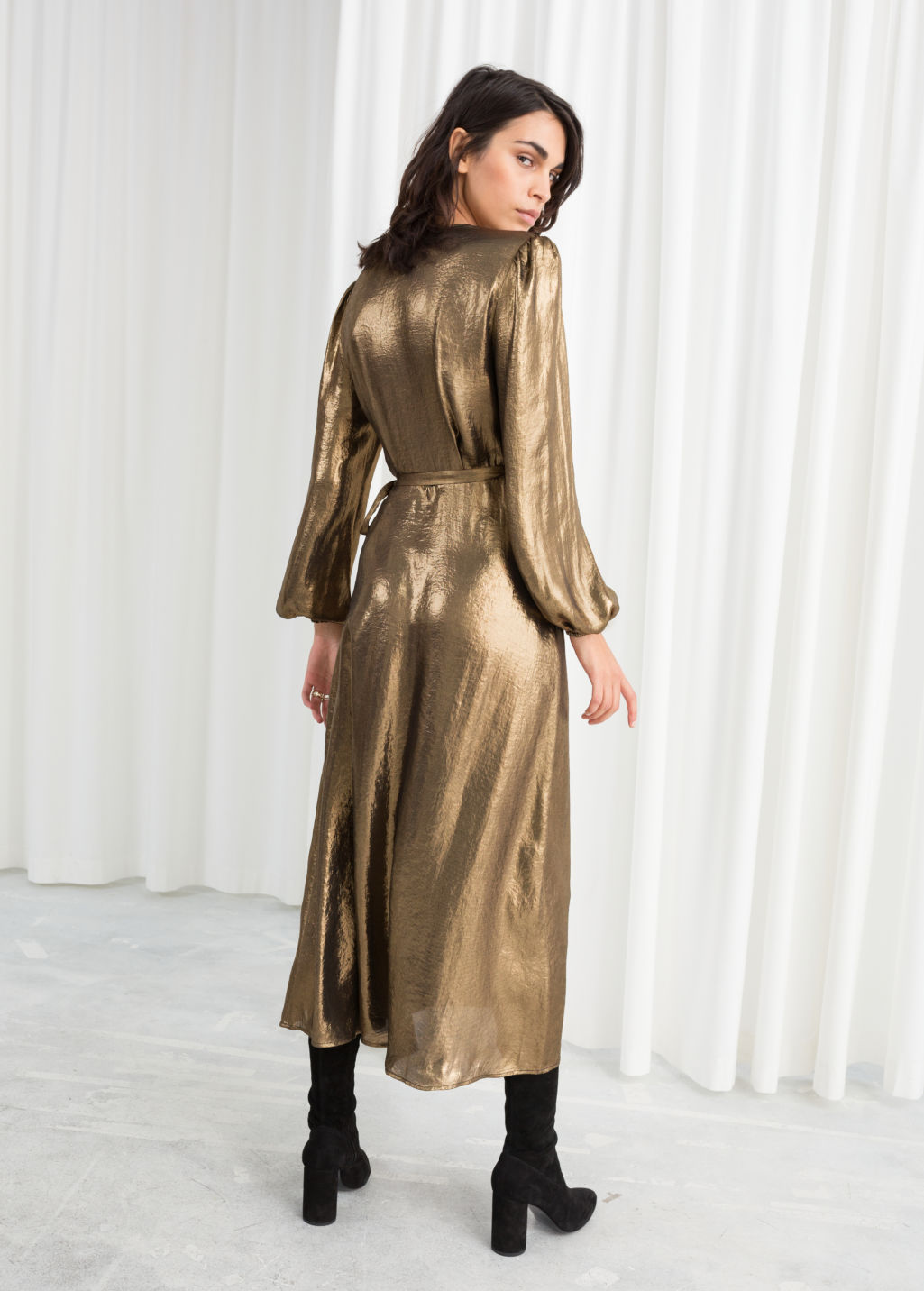 Model back image of Stories metallic satin midi dress in gold