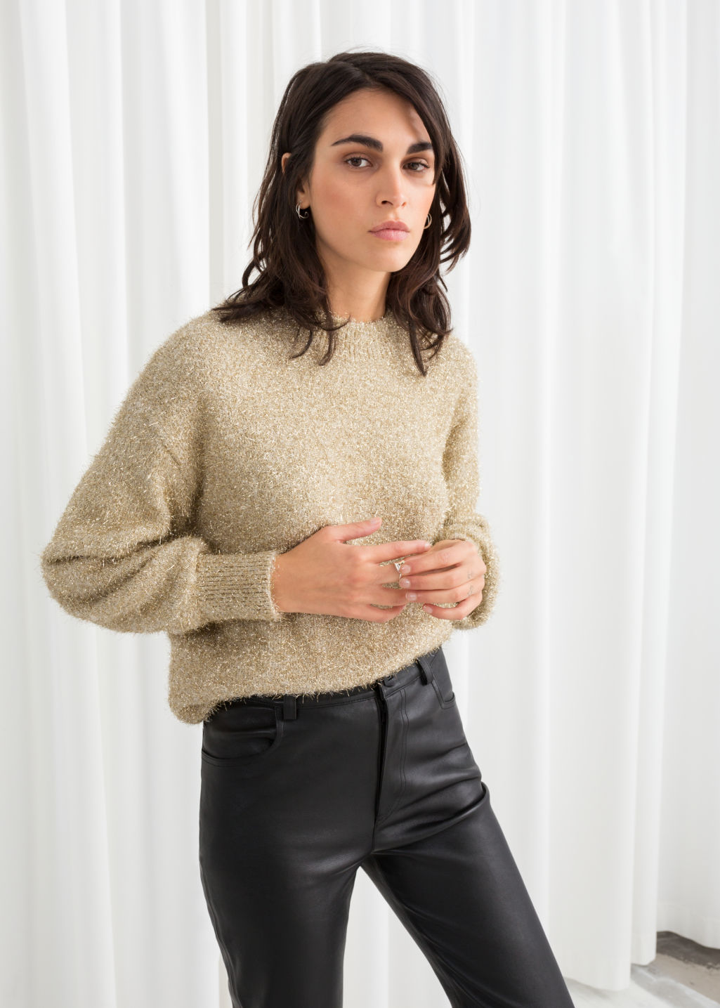 Model front image of Stories fuzzy metallic sweater in gold