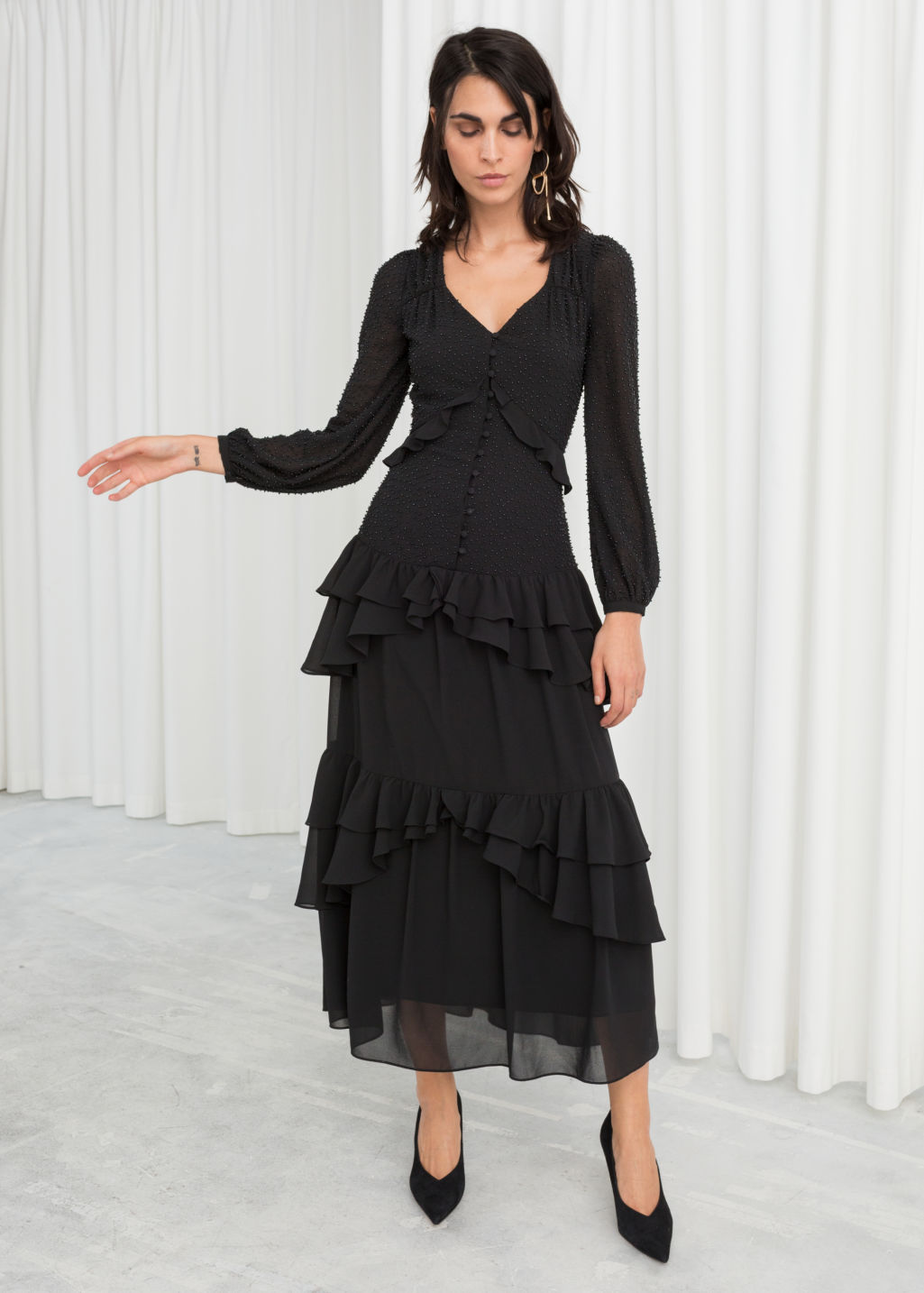 Model front image of Stories beaded ruffle midi dress in black