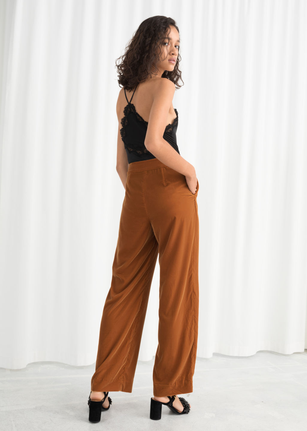 Model back image of Stories high waisted velvet trousers in orange