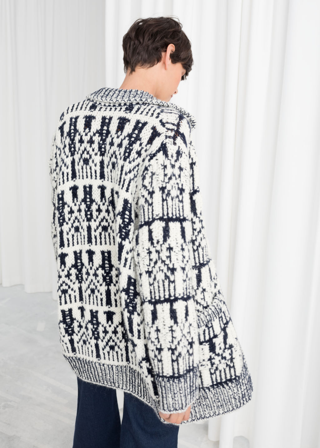 Model back image of Stories oversized chunky knit cardigan in white