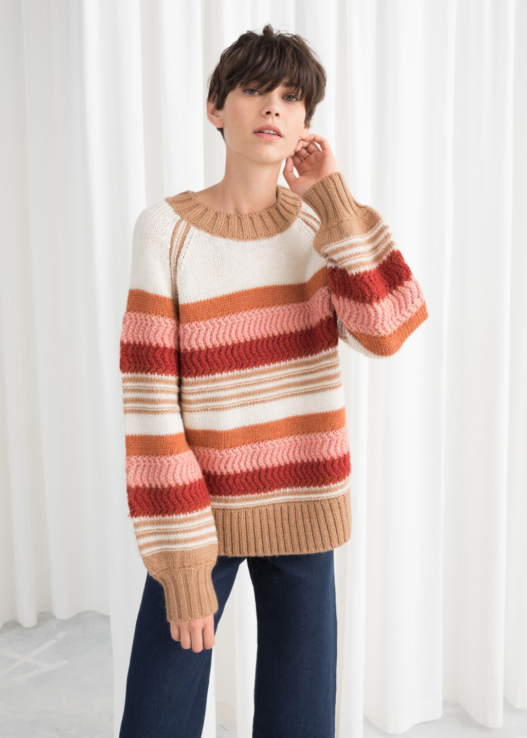 Model front image of Stories striped wool blend sweater in white