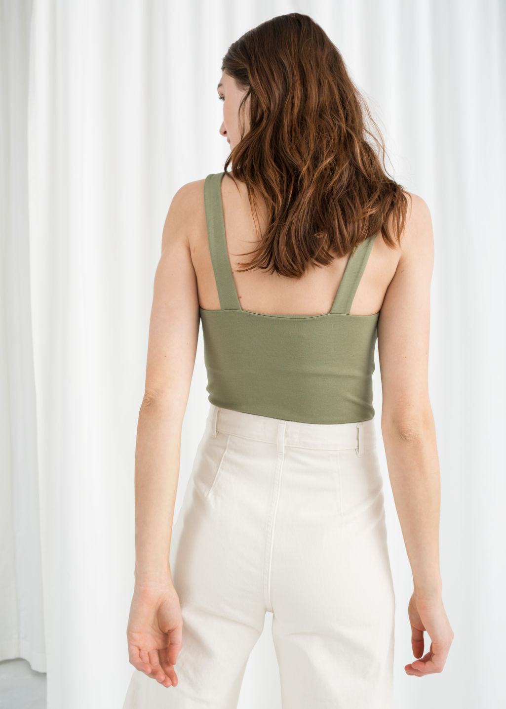 Model back image of Stories buckle strap tank top in green