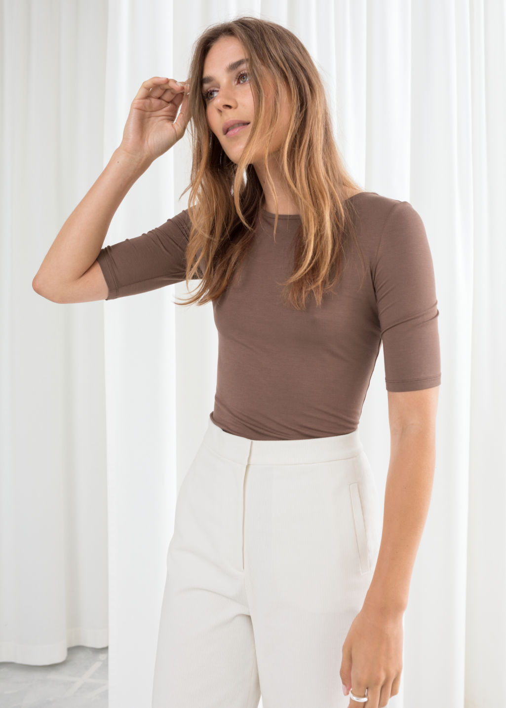 Model front image of Stories fitted boatneck top  in beige
