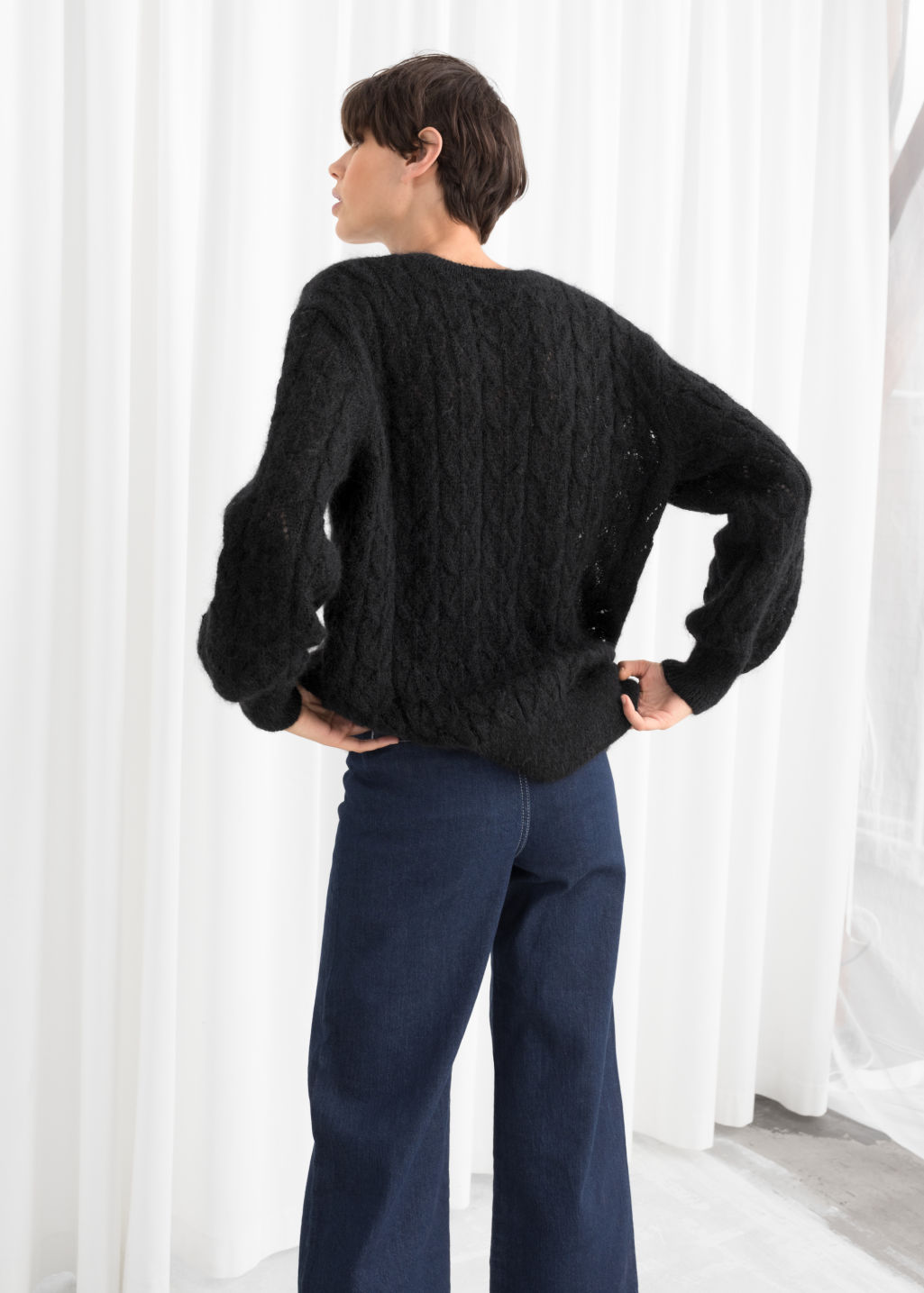 Model back image of Stories oversized eyelet knit sweater in black