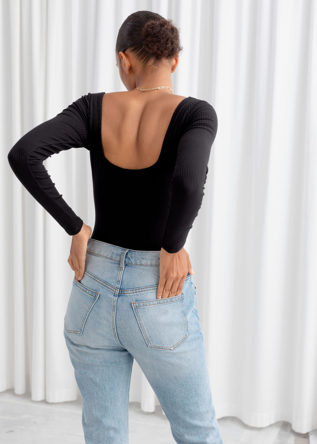 Model back image of Stories square neck bodysuit in black
