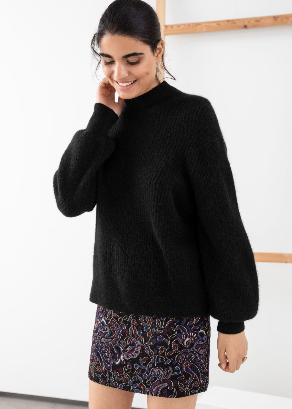 Model front image of Stories wool blend cable knit sweater in black