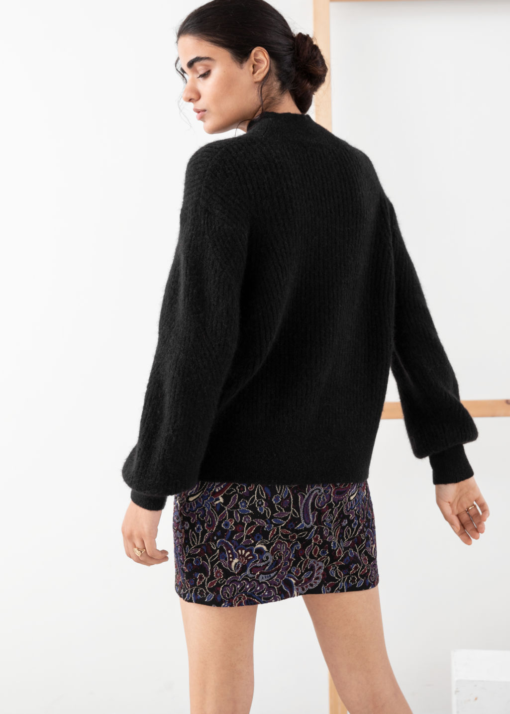 Model back image of Stories wool blend cable knit sweater in black