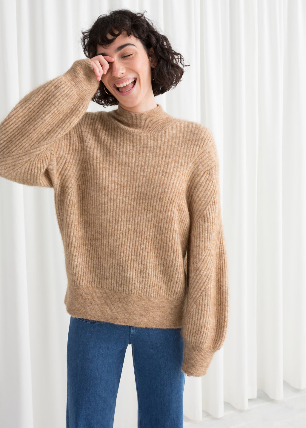 Model front image of Stories wool blend cable knit sweater in beige