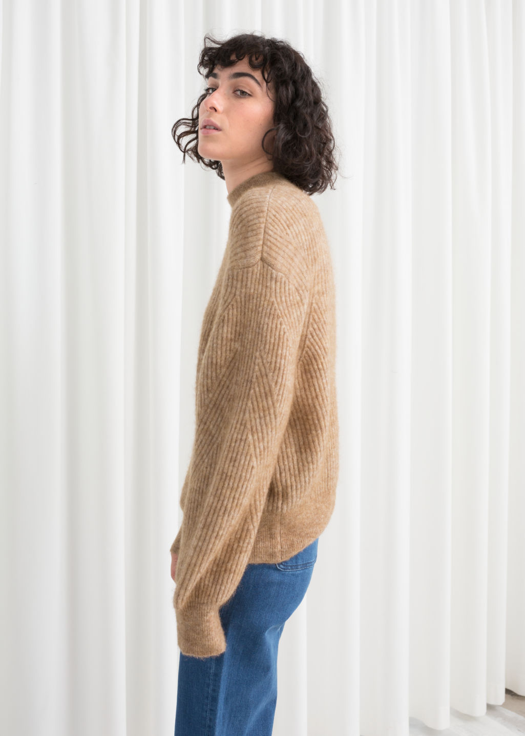 Model back image of Stories wool blend cable knit sweater in beige