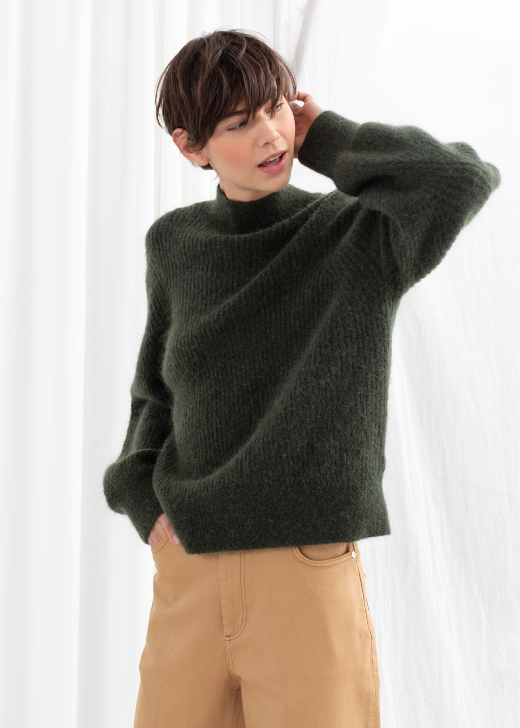 Model front image of Stories wool blend cable knit sweater in green