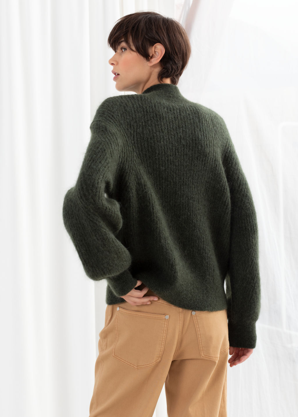 Model back image of Stories wool blend cable knit sweater in green