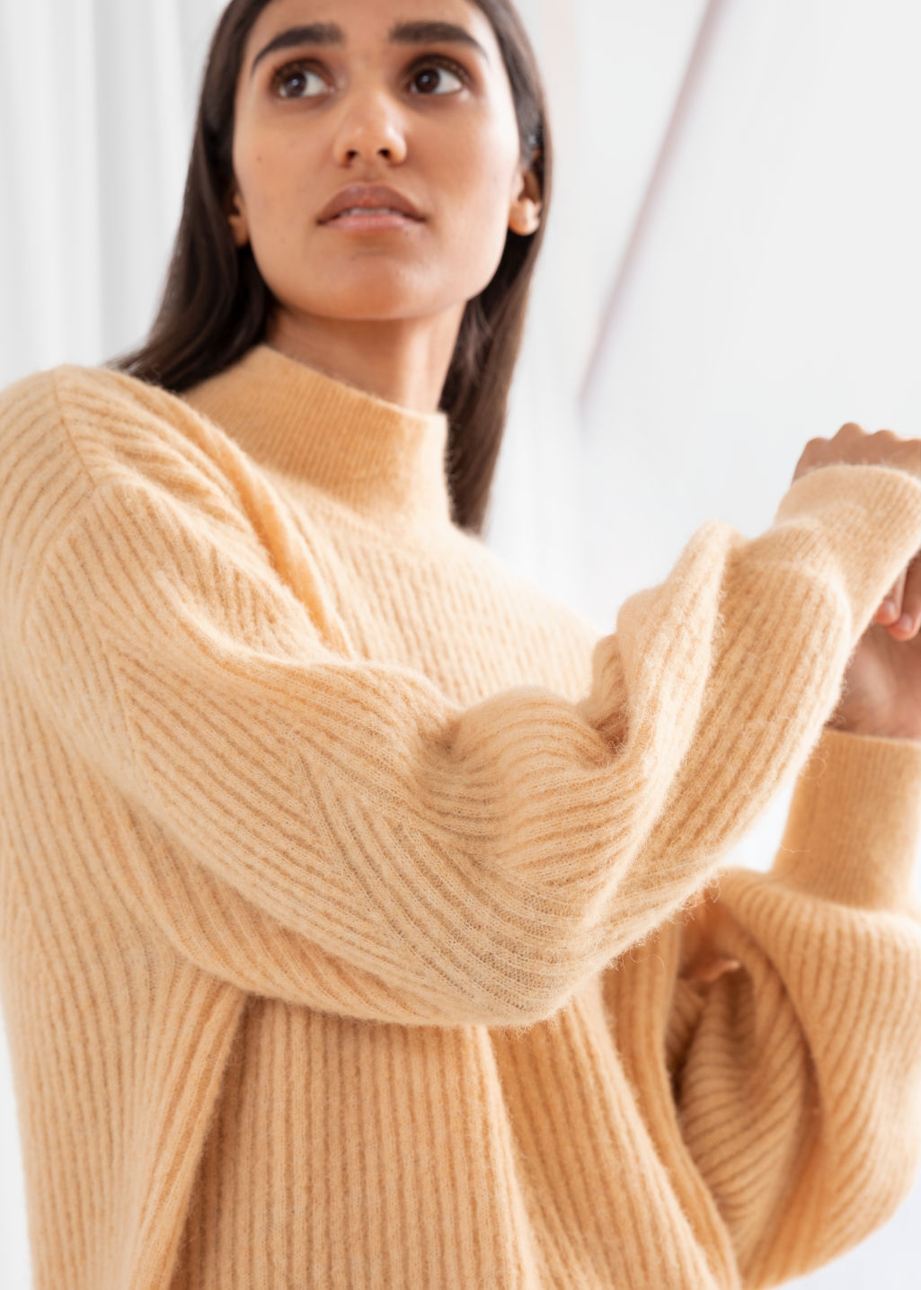 Model side image of Stories wool blend ribbed knit sweater in beige