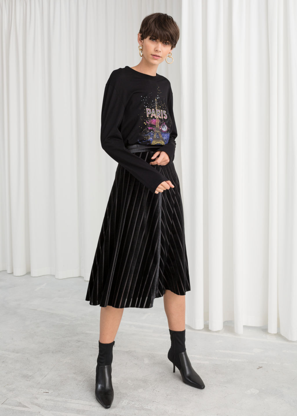 Model front image of Stories velvet chevron a-line skirt in black
