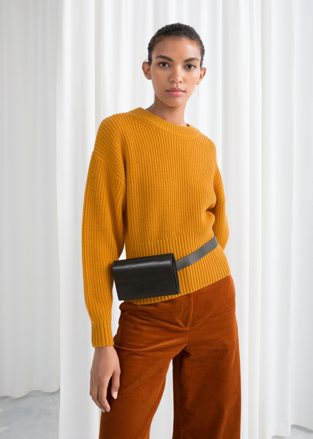 Model front image of Stories long rib cropped sweater in yellow