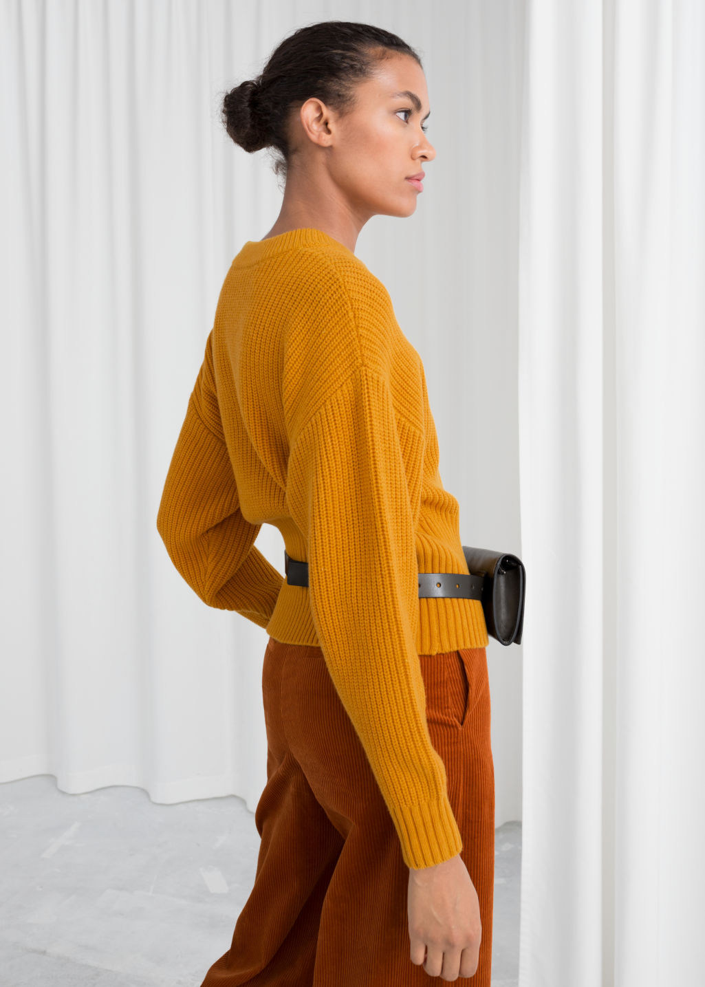 Model back image of Stories long rib cropped sweater in yellow