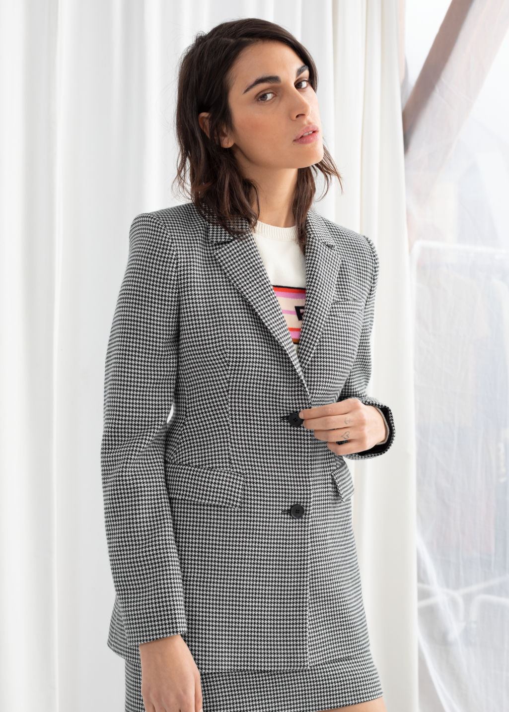 Model front image of Stories hourglass houndstooth blazer in black