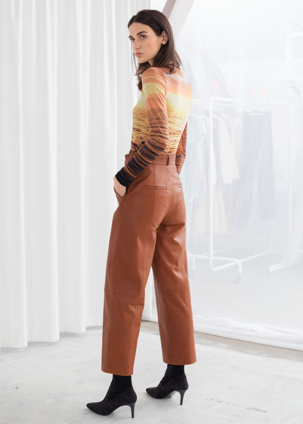 Model back image of Stories high waisted leather trousers in orange