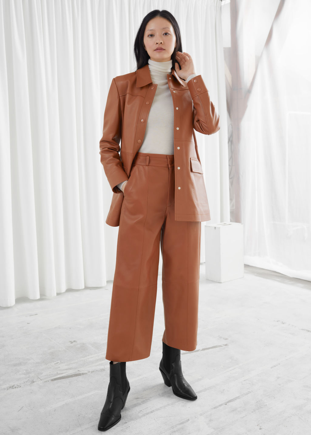 Model front image of Stories high waisted leather trousers in orange