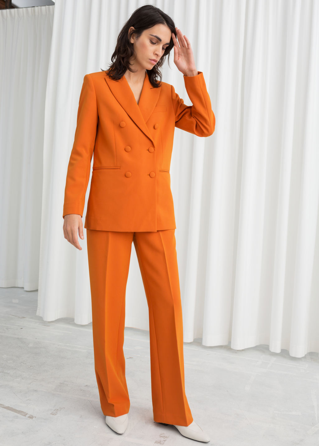 Model front image of Stories mid rise tailored trousers in orange
