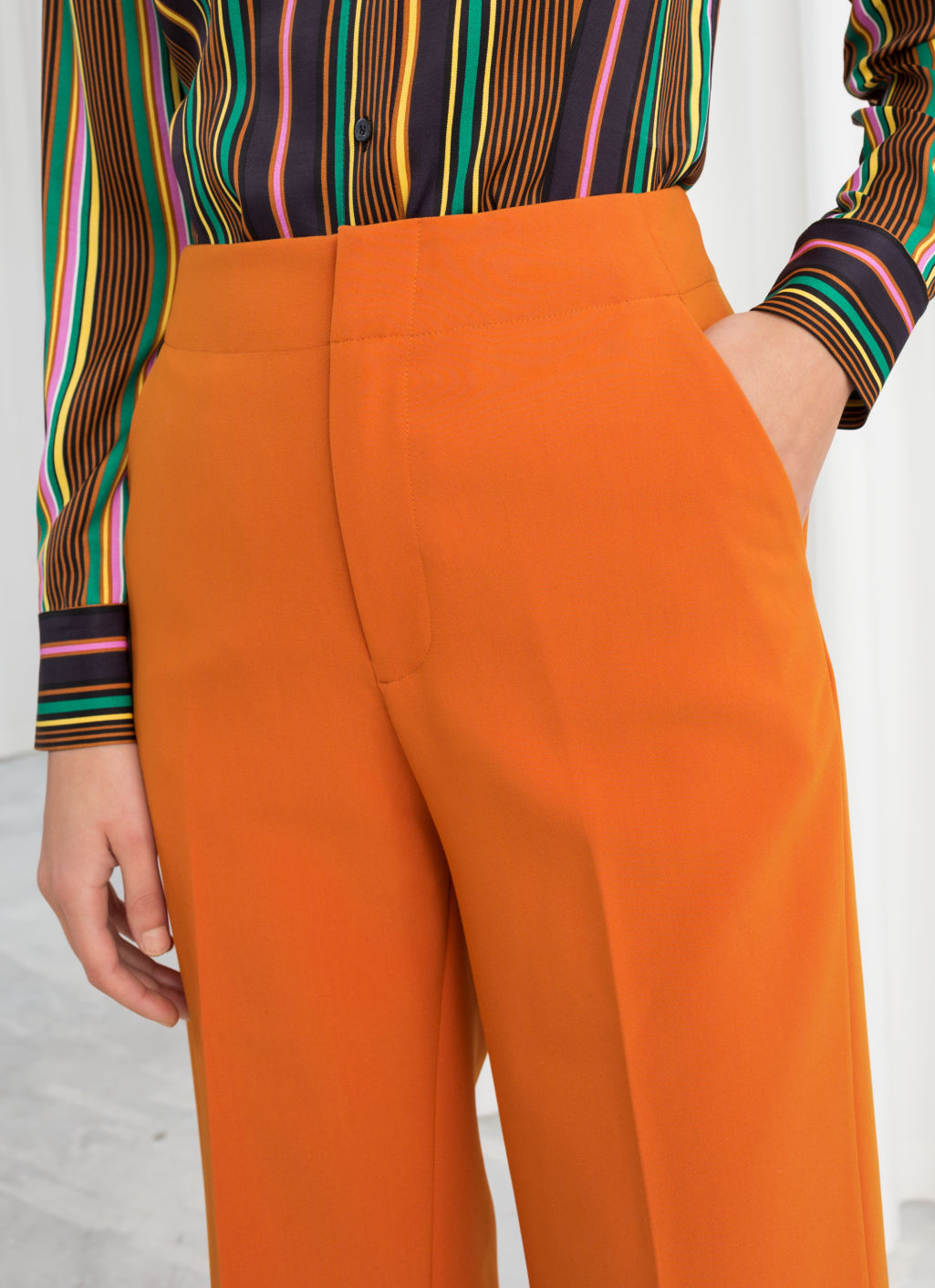 Model back image of Stories mid rise tailored trousers in orange