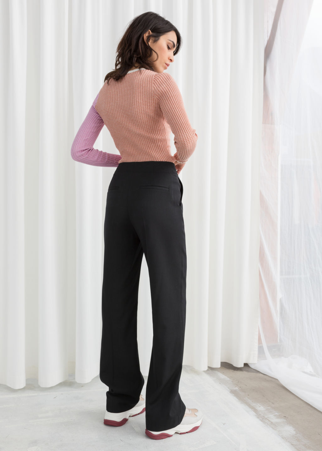 Model back image of Stories mid rise tailored trousers in black