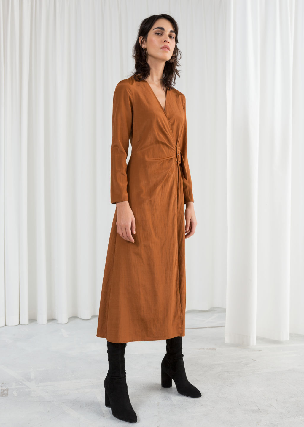 Model front image of Stories belted midi wrap dress in orange