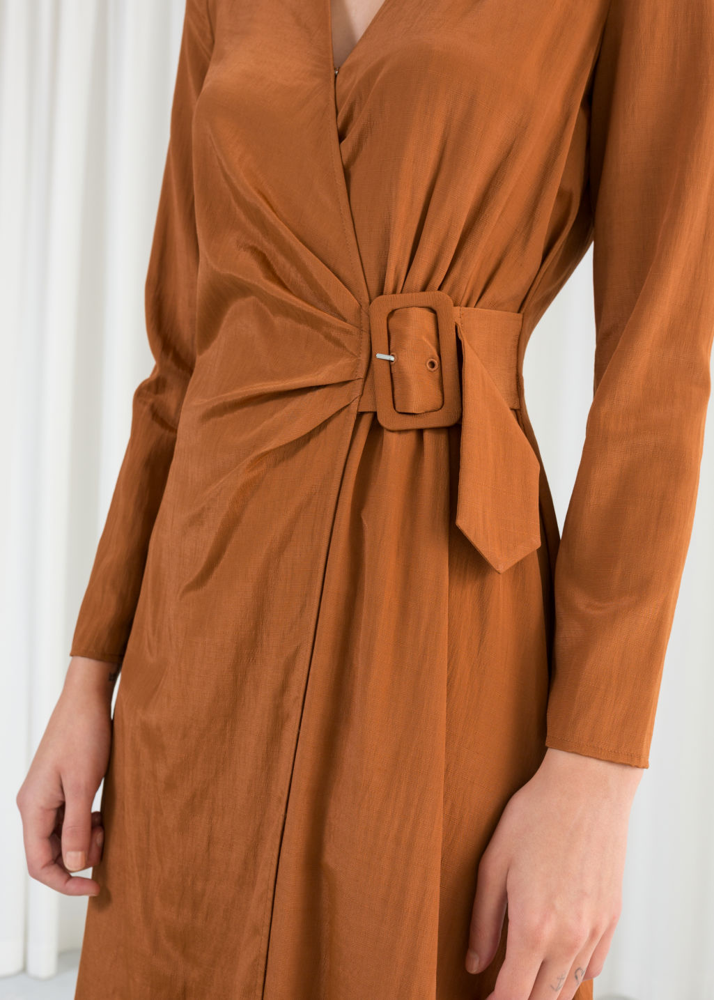 Model back image of Stories belted midi wrap dress in orange