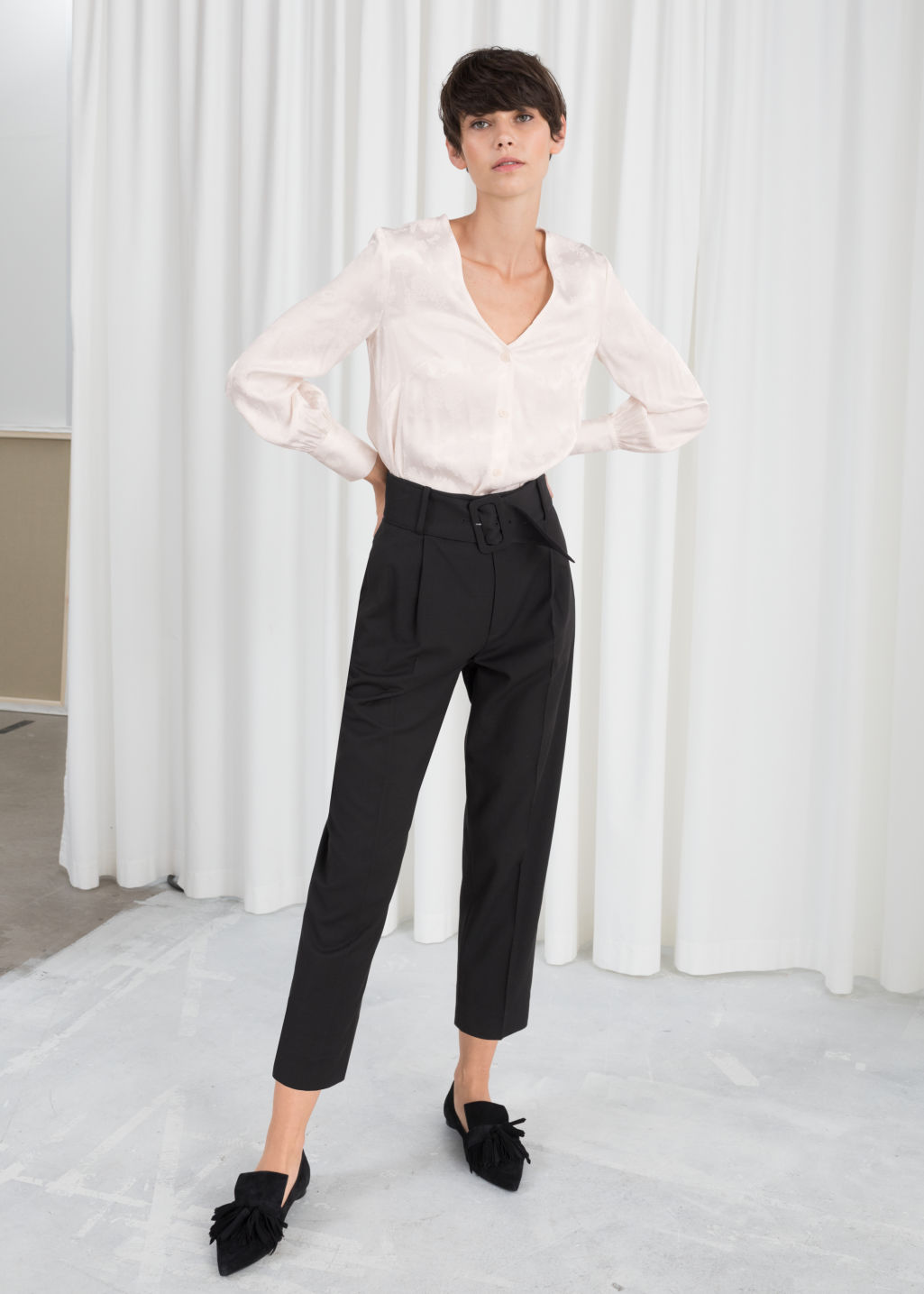 Model front image of Stories tapered belted trousers in black
