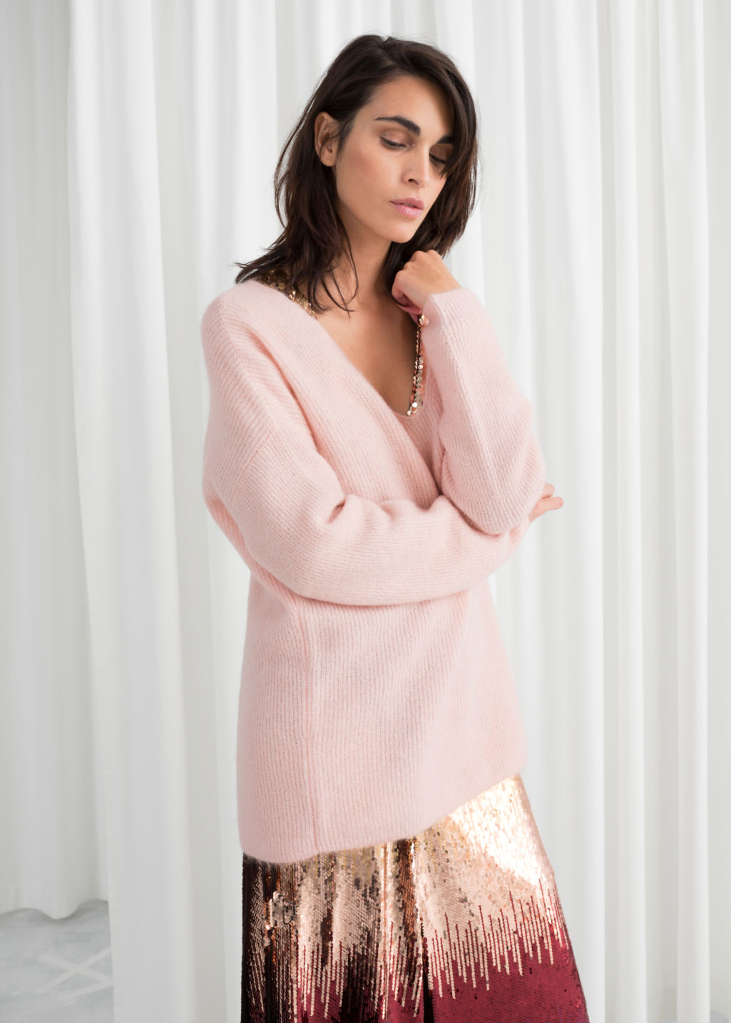 Model front image of Stories oversized wool blend sweater in pink