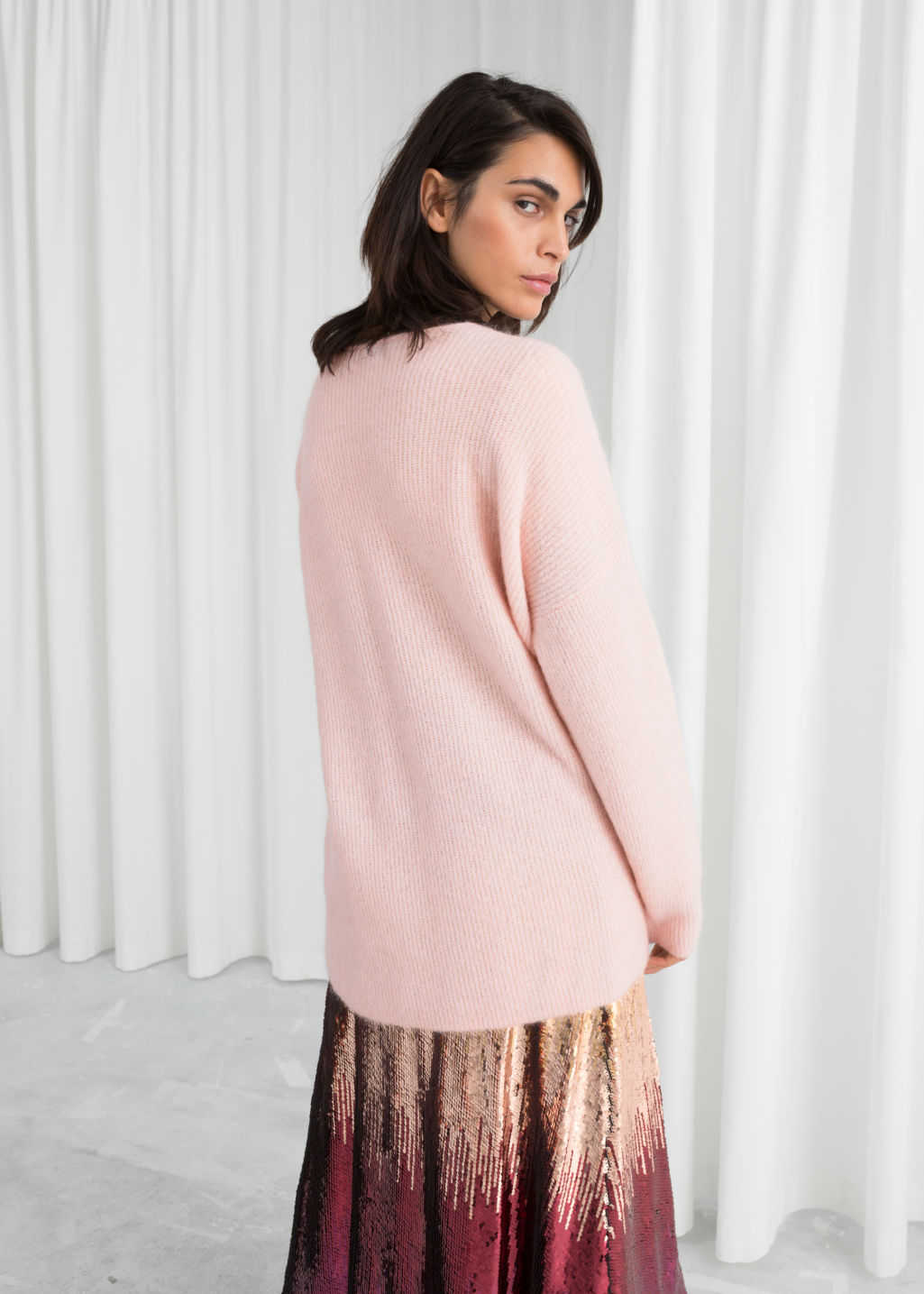 Model back image of Stories oversized wool blend sweater in pink