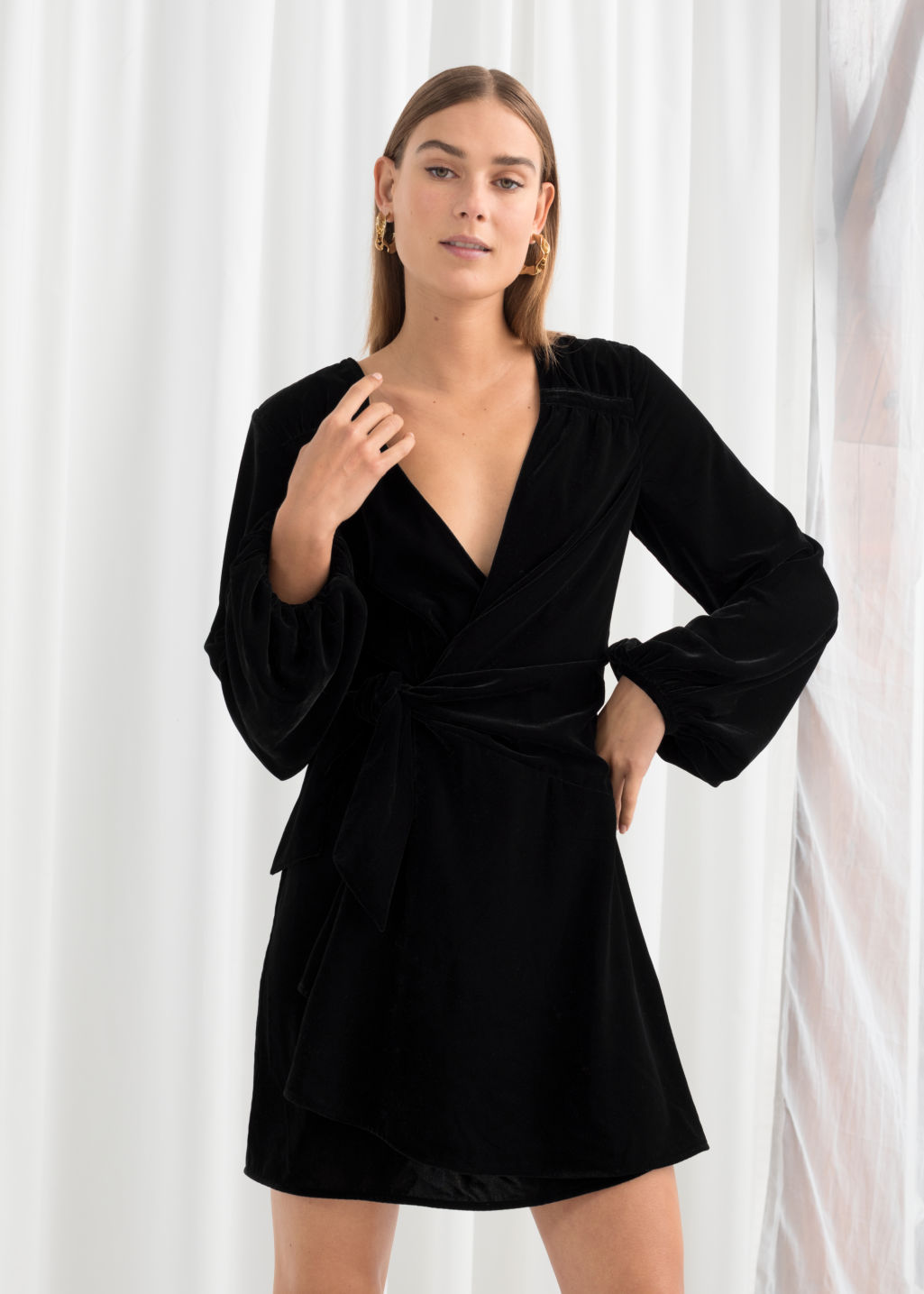 Model front image of Stories gathered velvet mini dress in black