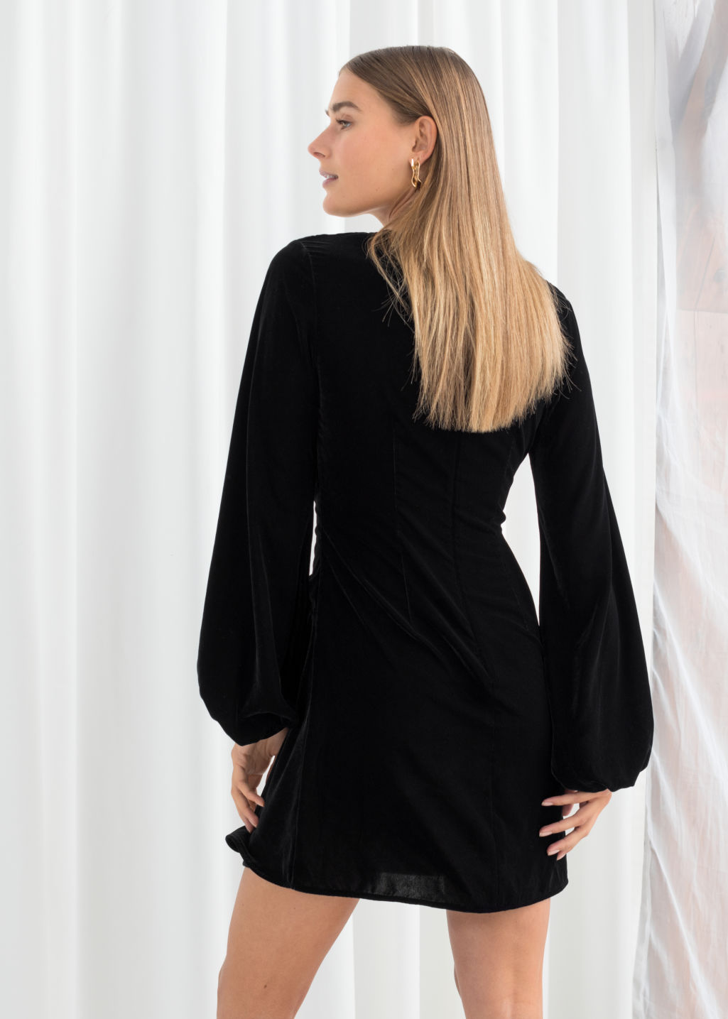 Model back image of Stories gathered velvet mini dress in black