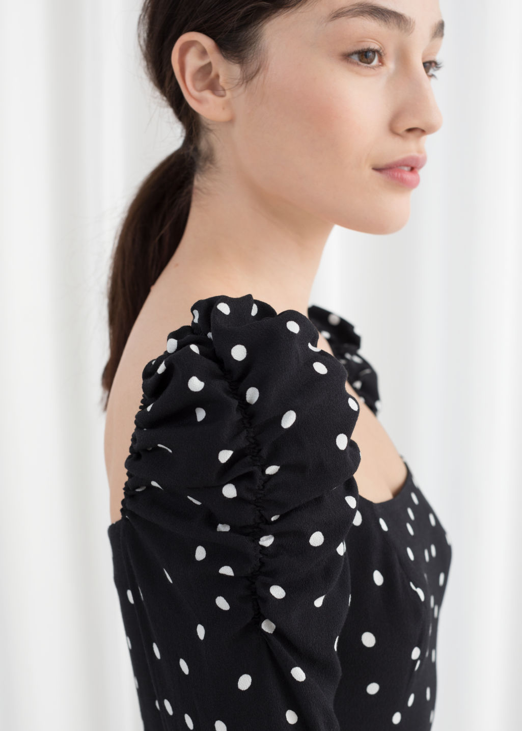 Model back image of Stories ruched floral maxi dress in black