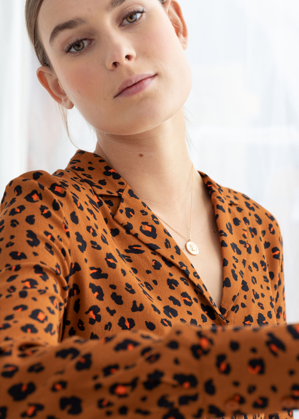 Model front image of Stories v-neck button up blouse in orange